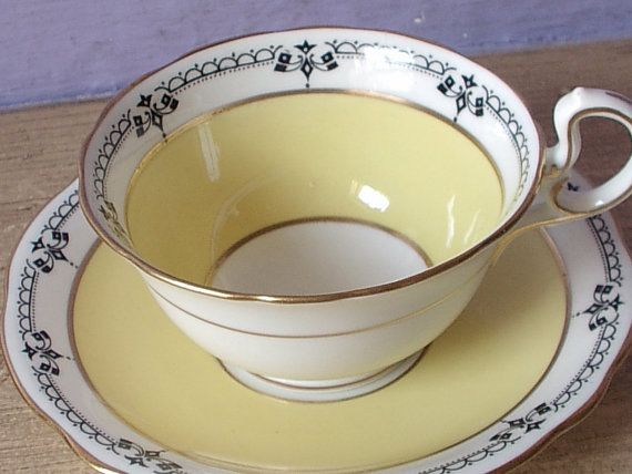 Antique Aynsley yellow tea cup and saucer art by ShoponSherman