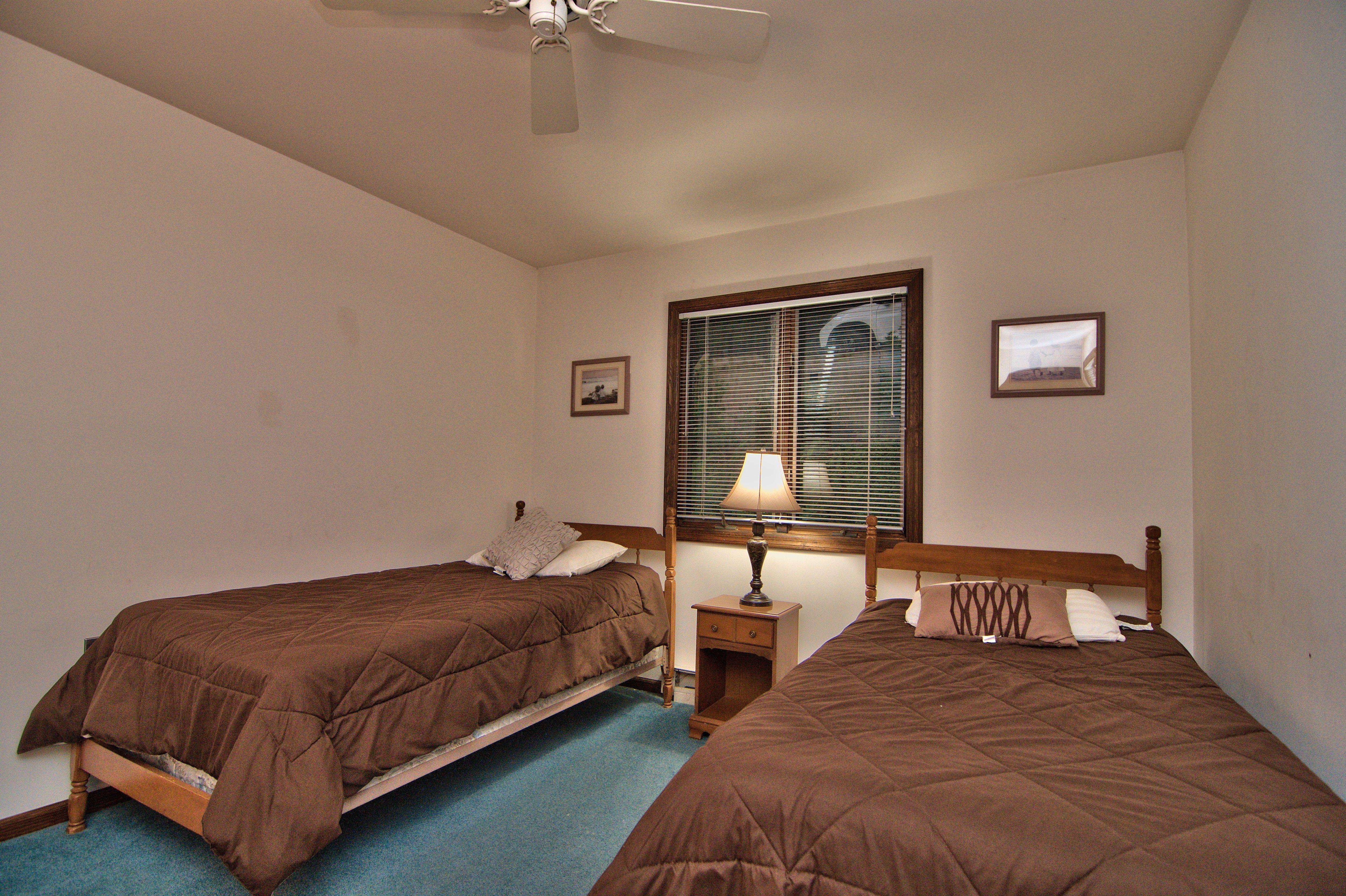 Another relaxing bedroom in this lakefront house for rent