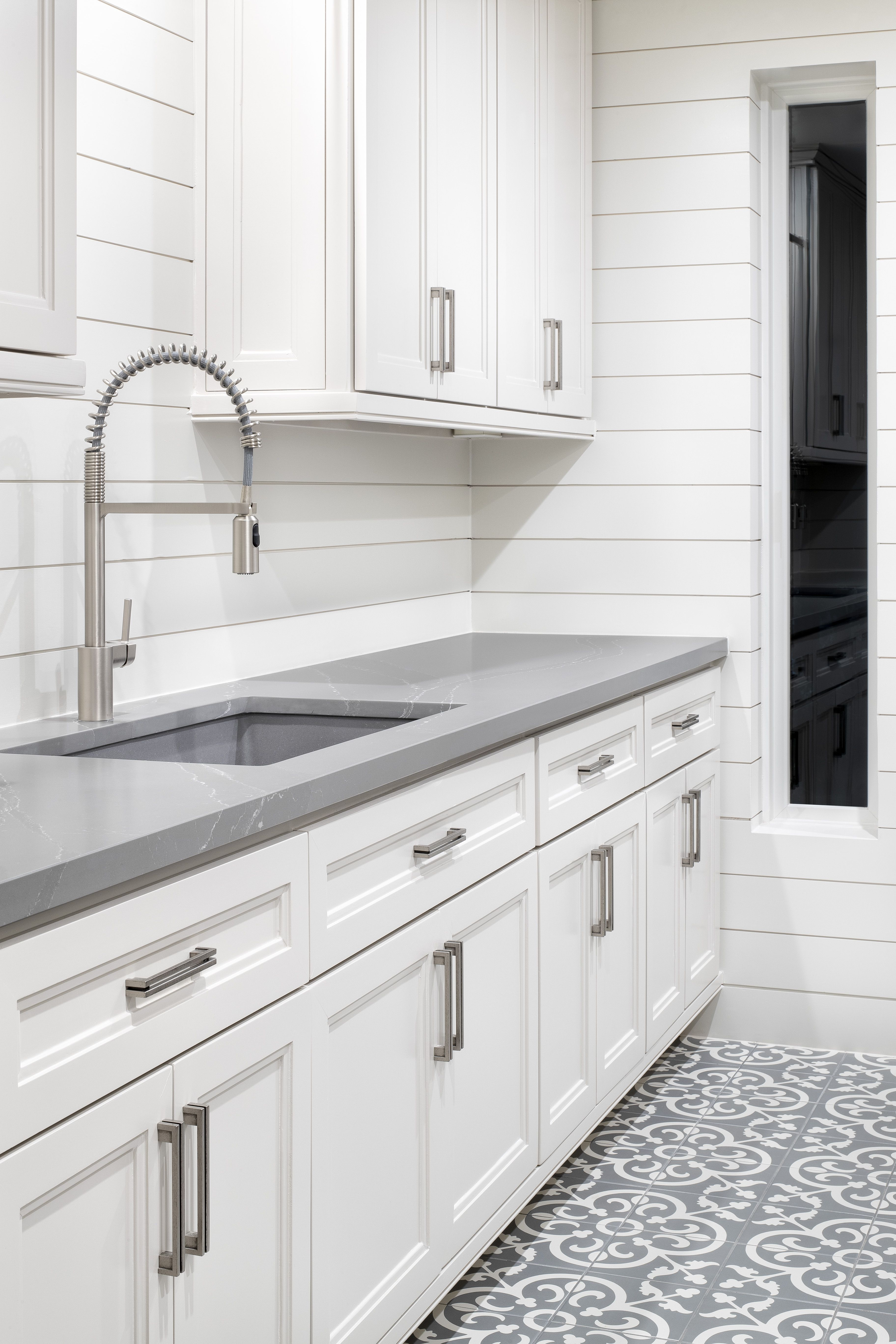 A Modern Farmhouse Utility Room In Austin Texas In 2020 Grey Kitchen Floor Gray Kitchen Countertops Kitchen Cabinets Grey And White
