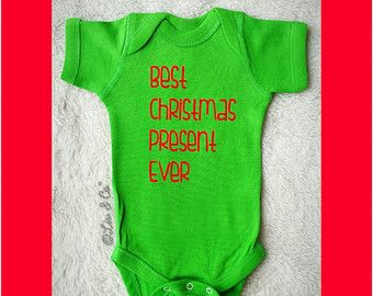 18298795e Best Christmas Present Ever Funny Baby and Toddler Christmas One Piece  Bodysuit and Shirt Outfit. Boy or Girl Christmas Clothes.© Liv & Co.™