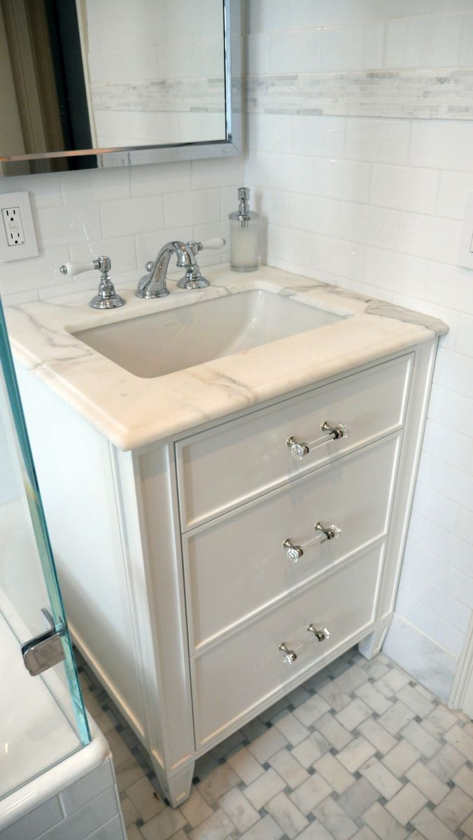 A custom white vanity holds court in a traditional style pre-war ...