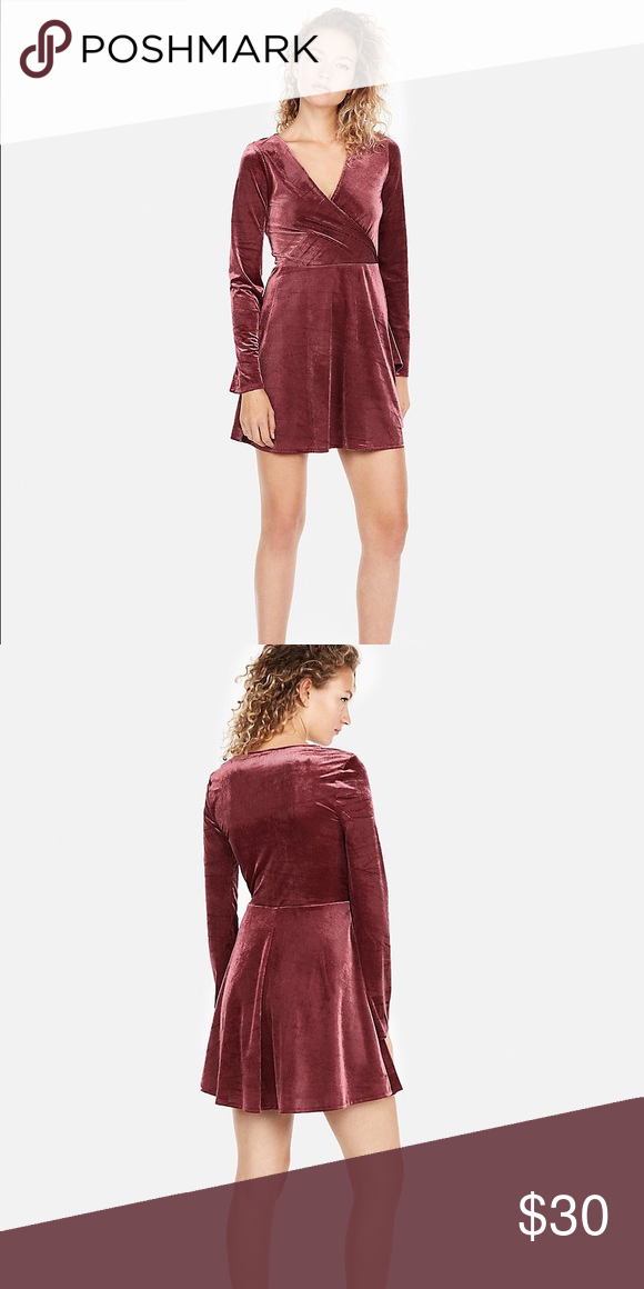 4656b3108e Express velvet surplice fit and flare dress New with tags!! Ribbed velvet  in a mulled wine color. Bell sleeves make it a unique dress!