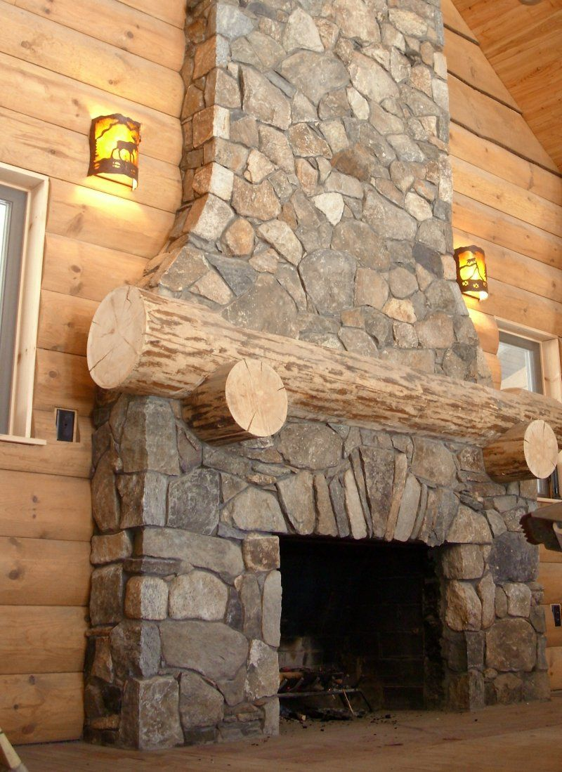 Rustic log cabin fireplace project with thin natural stone for Cabin fireplace pictures