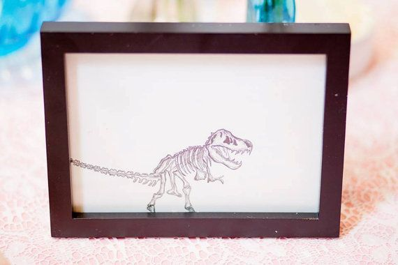 This cute dinosaur drawing makes a great wedding table number for a NYC themed wedding representing the Museum of Natural History.  By Pineapple Street Designs.