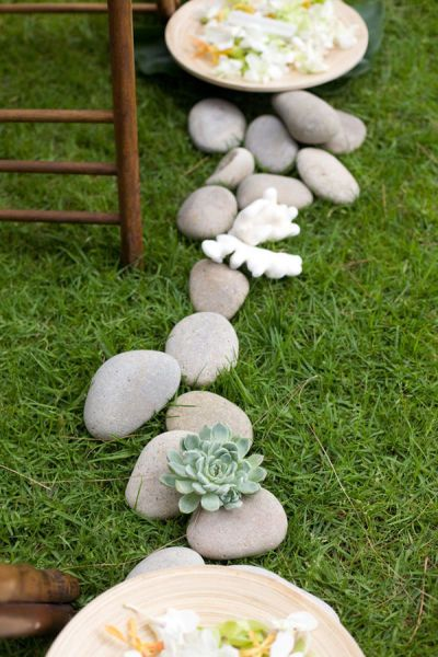 Aisle decor - rocks, bowls, coral, flowers...could be so pretty for an evening garden party, or along a flowerbed edge with candlights flickering...lots of potential