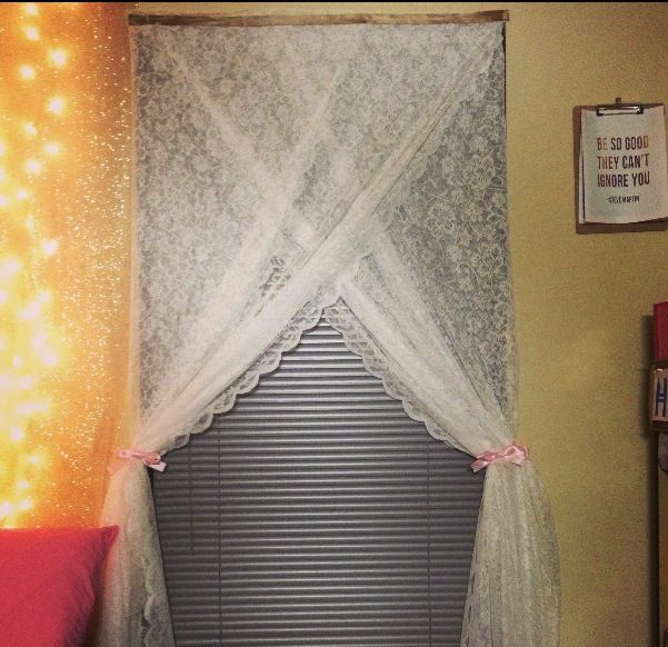 My curtains for my dorm room made from two long pieces of lace fabric overlapped tacked up and tied with light pink ribbon :) | College Packing List Pdf | Room Decoration Ideas College | No Friends First Week Of College | How To Decorate Concrete Dorm Walls. #beauty #College/Dorm Room #collegepackinglist