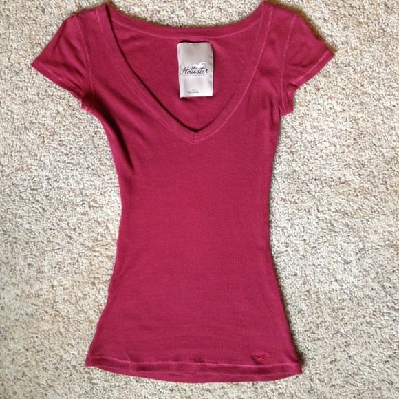 Maroon Hollister V-neck Small Maroon Hollister V-neck shirt. Great condition besides small hole on bottom. Not noticeable. Hollister Tops