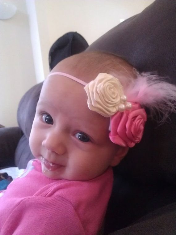 Ribbon Roses Headband With Feather by ShareTheWell on Etsy, $8.00. Look at that gorgeous model! :)