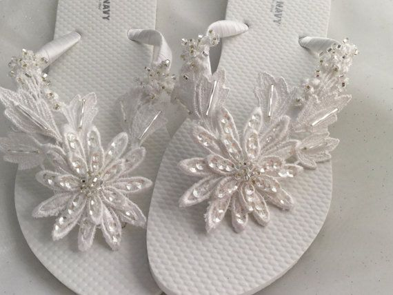 9a11fb6fbe091f This beautiful white flip flops is wrapped with white satin ribbon