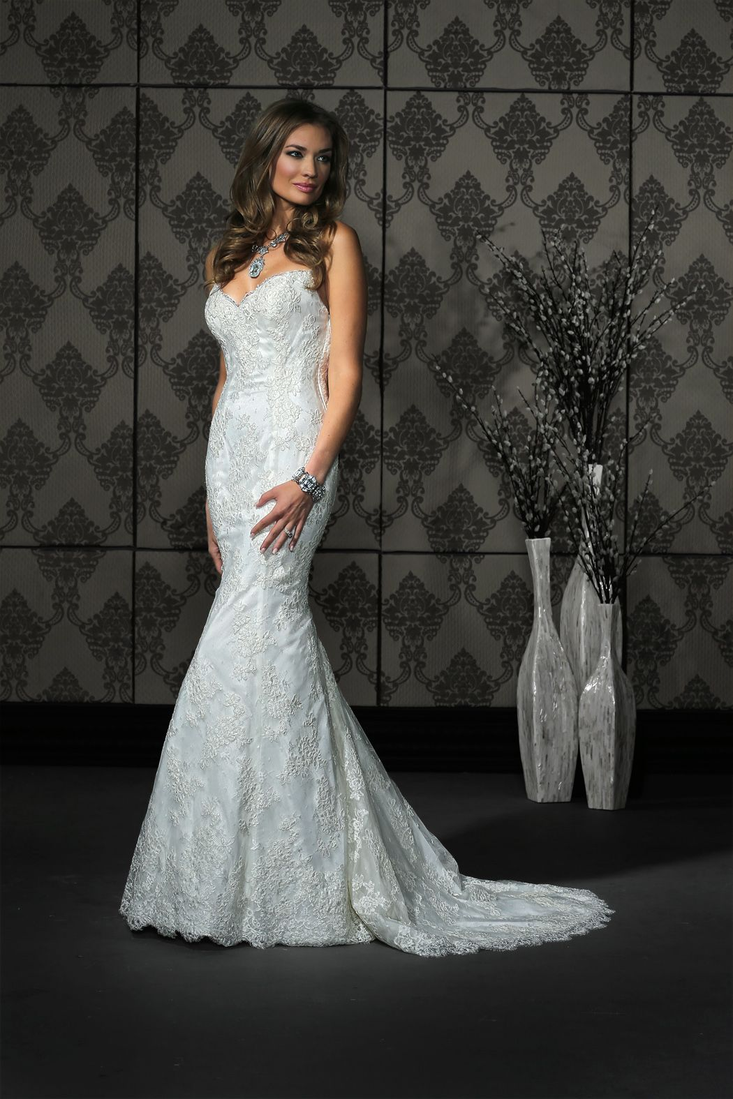 Style features classic all over lace and a surprise illusion