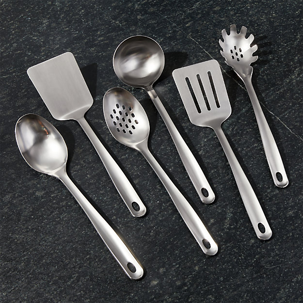 Shop Crate and Barrel Brushed Stainless Steel Utensils.  Beautiful stainless steel kitchen utensils to tackle any kitchen task.  Their streamlined structure and brushed stainless steel finish look great on the stove, at the table or hanging from the handy eyelet.