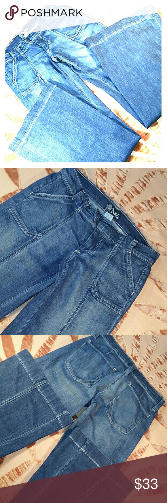 Superflares Low rise stretch bellbottom superflare jeans. 98%cotton 2%polyurethane. Thin super stretchy. Cool 70s details. Bells measure 22INCHES!!! Rise measures 6.5inch. EXCELLENT CONDITION Anlo Jeans Flare & Wide Leg