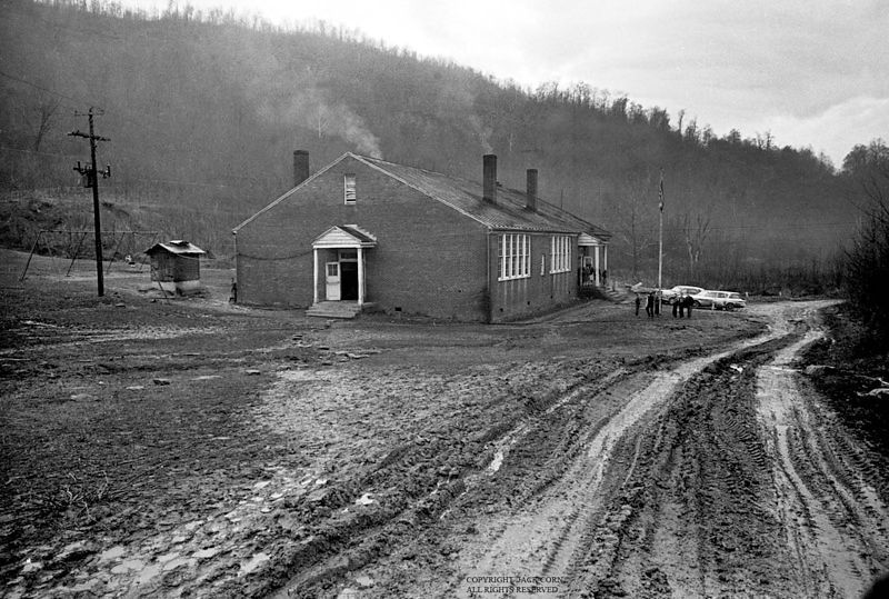 Brick School, muddy road, Clairfield.  Jack Corn Photography