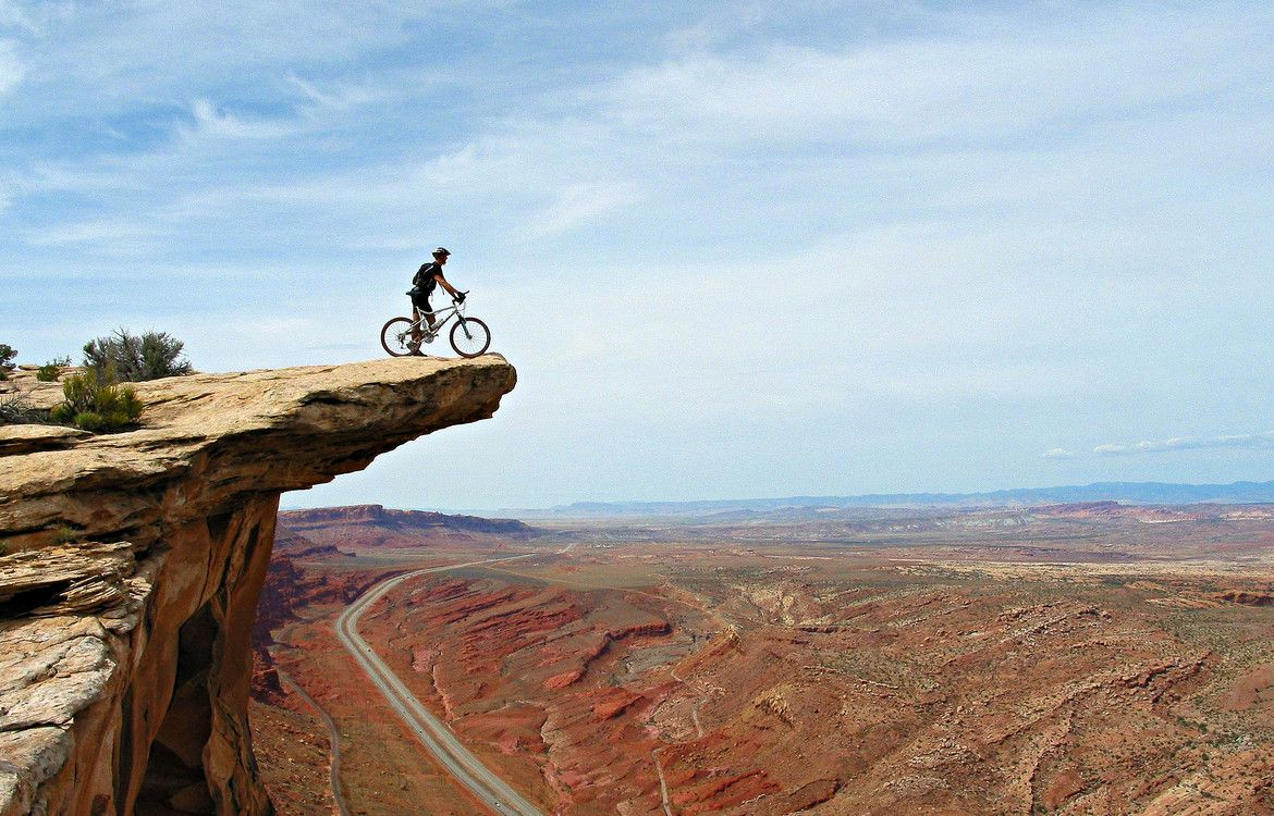 Awesome Picture Of A Biker On The Edge Of A Cliff In