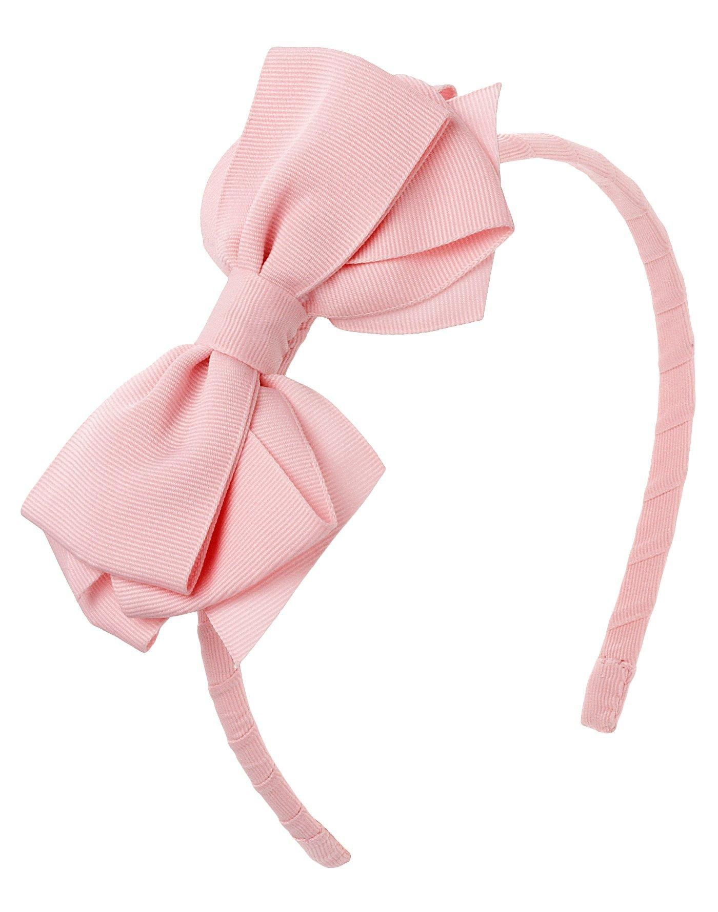 A fashionable and chic look our bow headband in luxurious