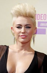 miley cyrus dishes on her beautiful wedding dress  short