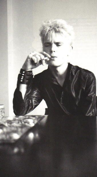 Billy Idol smoking a cigarette (or weed)