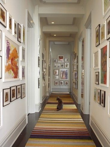 loving this long hallway w/ a gallery of frames