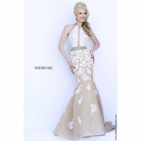 Sherri Hill Amazing Fitted Dress Brand New! Size 0! Sherri Hill Dress is a stunning mermaid style lace dress. This ivory dress features a beautiful beaded halter neckline. The fitted mermaid style skirt features a nude color skirt with ivory lace applique. Sherri Hill has western style turquoise bead work and a fitted silhouette which would be a phenomenal look as a homecoming dress or special occasion dress. Sherri Hill Dresses Prom