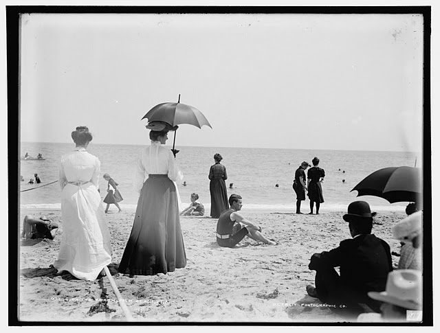 Victorian beach scene long dresses umbrellas 1880 1900 vintage edwardian fashion bowler hat seaside black and white photography photo print