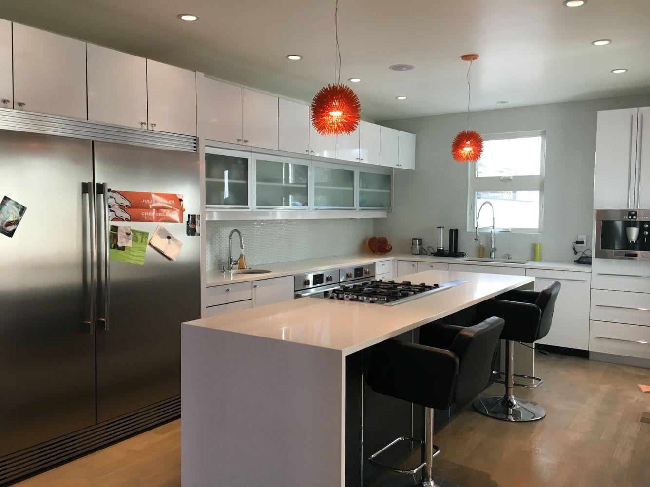 Modern kitchen with Bosch appliances - oversized fridge , double oven , double sink , island ...