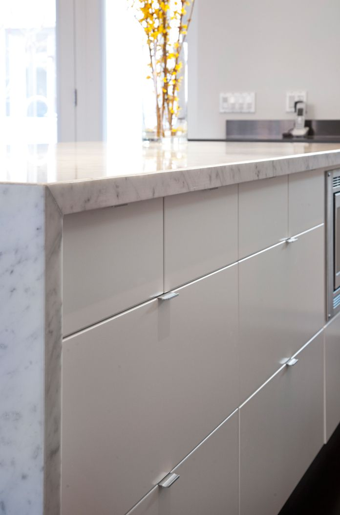 kitchen island, detail of waterfall counter, over Ikea Aplad cabinets