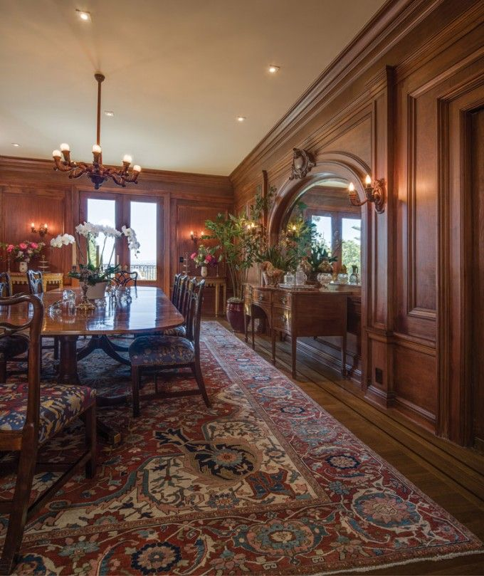 Art Level 19th Century Oversize Serapi Carpet Perfectly Completes Wood Paneled Dining Room