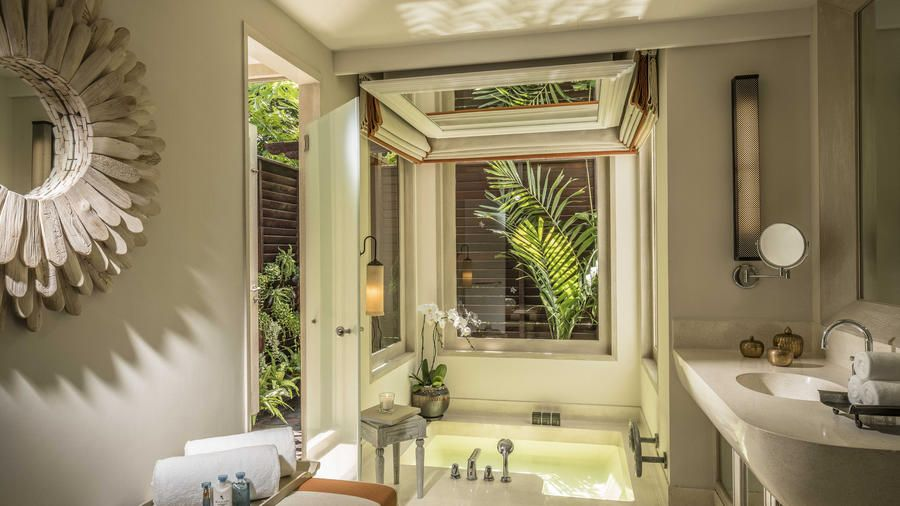 12 Tropical Hotels With The Outdoor Showers Of Your Dreams Indoor Jacuzzi Tropical Bedrooms Coastal Living