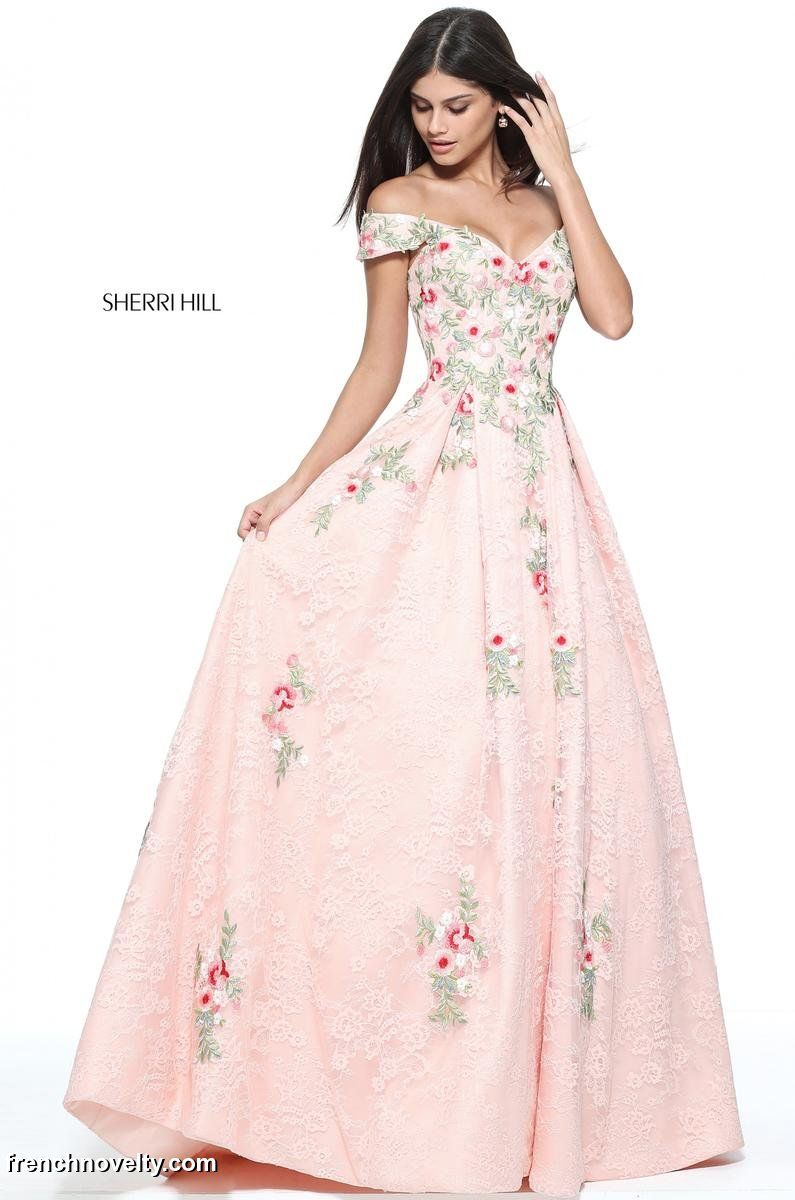 7e08ac6d6b00 Sherri Hill 51189 is an off the shoulder lace prom dress adorned with floral  appliques.