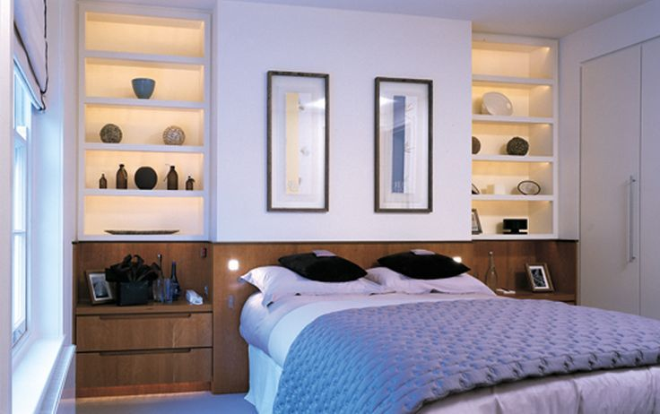 Master Bedroom, clever use of wood for cabinets and chimney breast ...