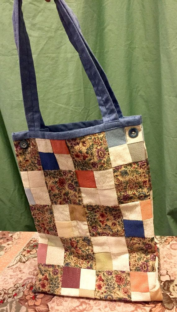 Hand made quilted lunch bag with 2 side snaps (non insulated) This would make a great teacher gift!  Dimensions: 9 x 12 x 5