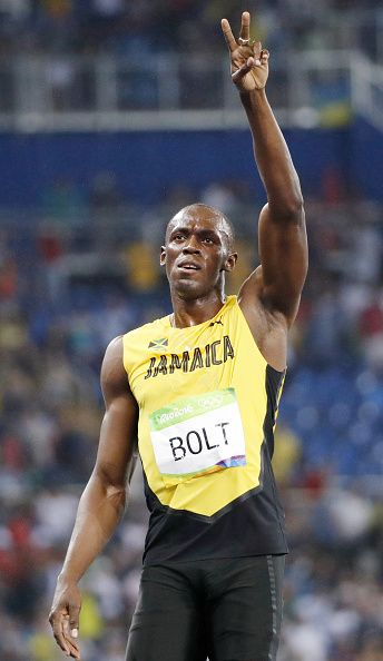 Usain Bolt of Jamaica acknowledges the crowd after winning ...
