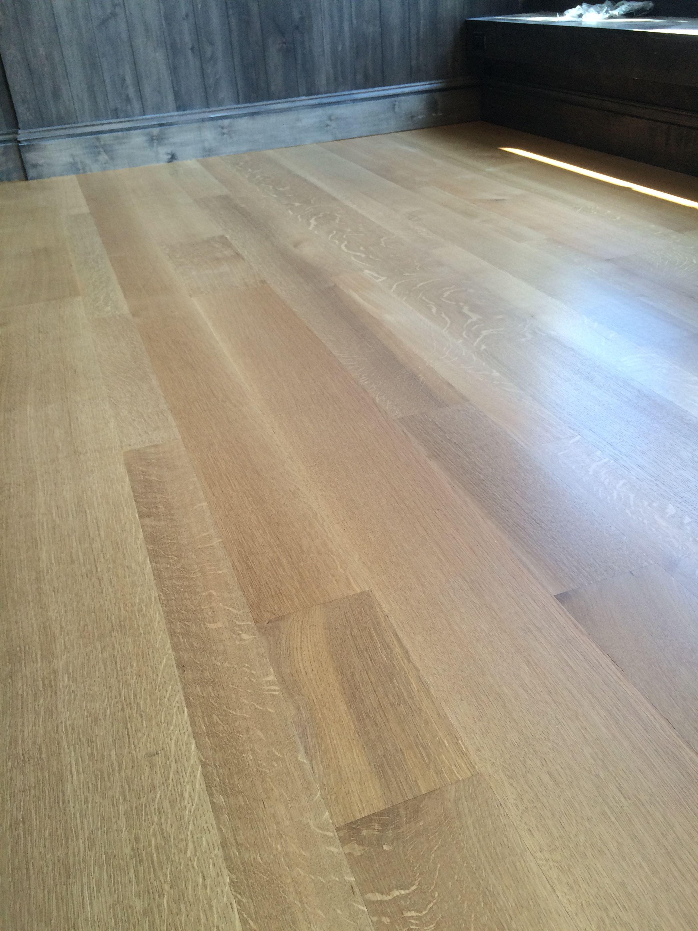 Wide plank random width quarter sawn white oak hardwood flooring with bona traffic hd system