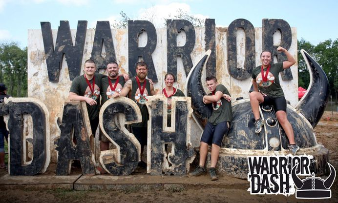 "Warrior Dash runners in this obstacle race braved the ""Warrior Roast"" mud, ropes and more until the very muddy end!  Jorge photographed at the fire jump and Amy shot at the iconic helmet post-race."