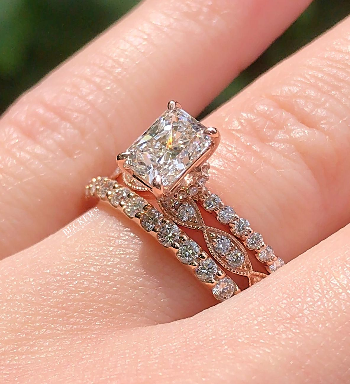 Our new radiant cut engagement ring just begs to be stacked with