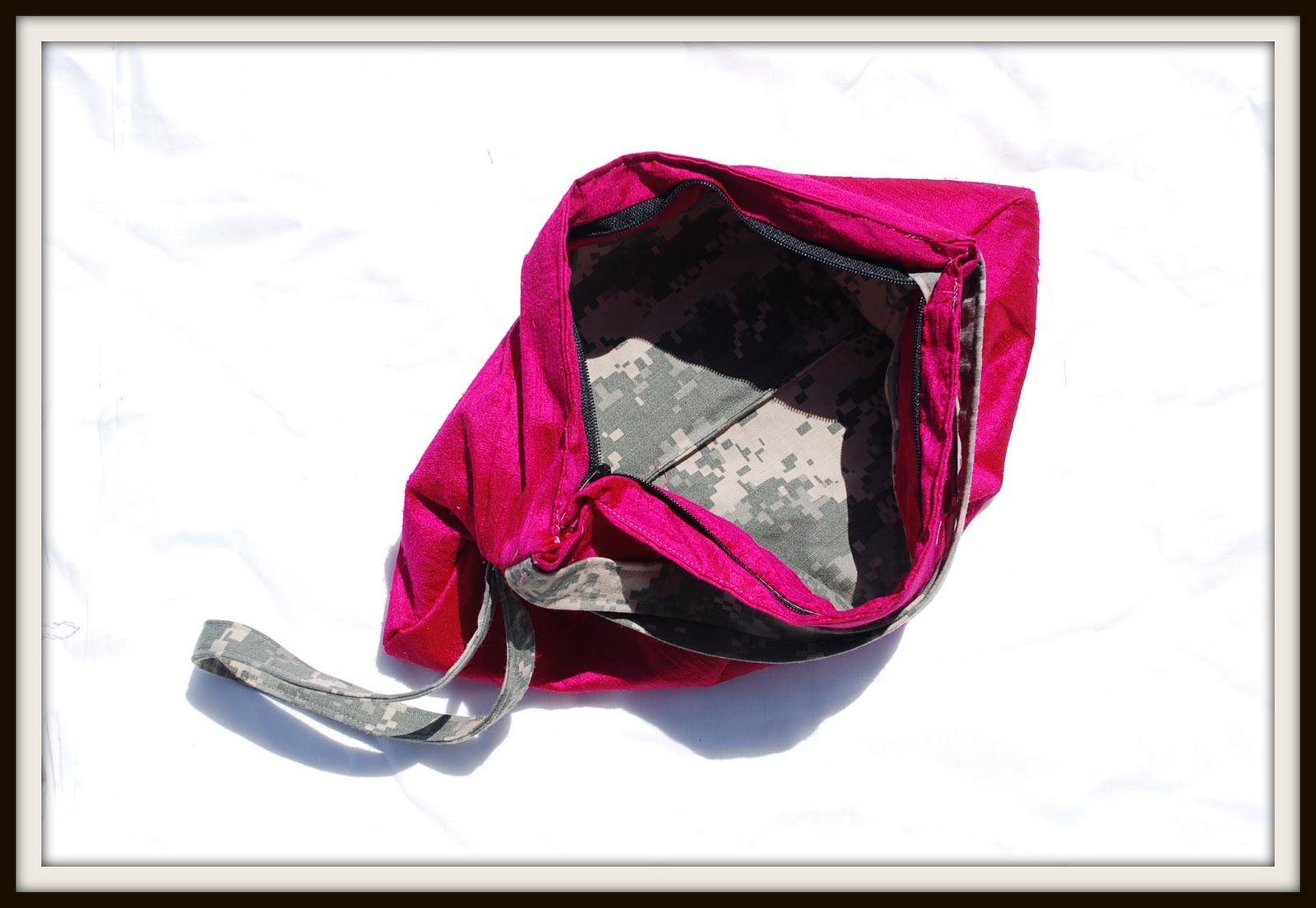 A neon silk Nola Bag with ACU lining