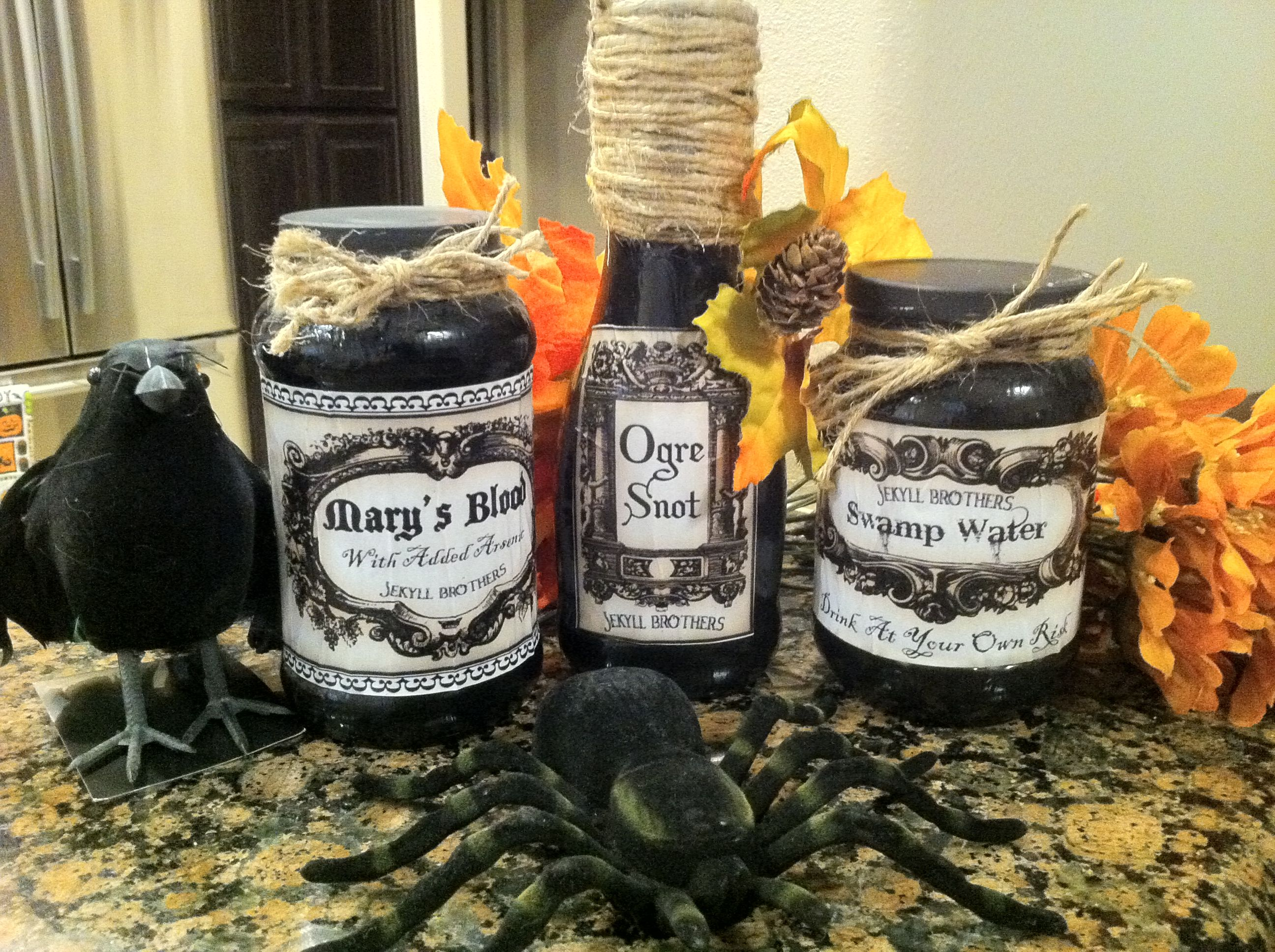 Check out my Halloween Potion Jars I made using Modge Podge, decorative rope, glass spaghetti sauce jars and some labels I printed off the Internet. Just paint the jars solid black! They look Spooktacular in my kitchen!!