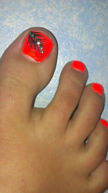 neon orange toes with feather