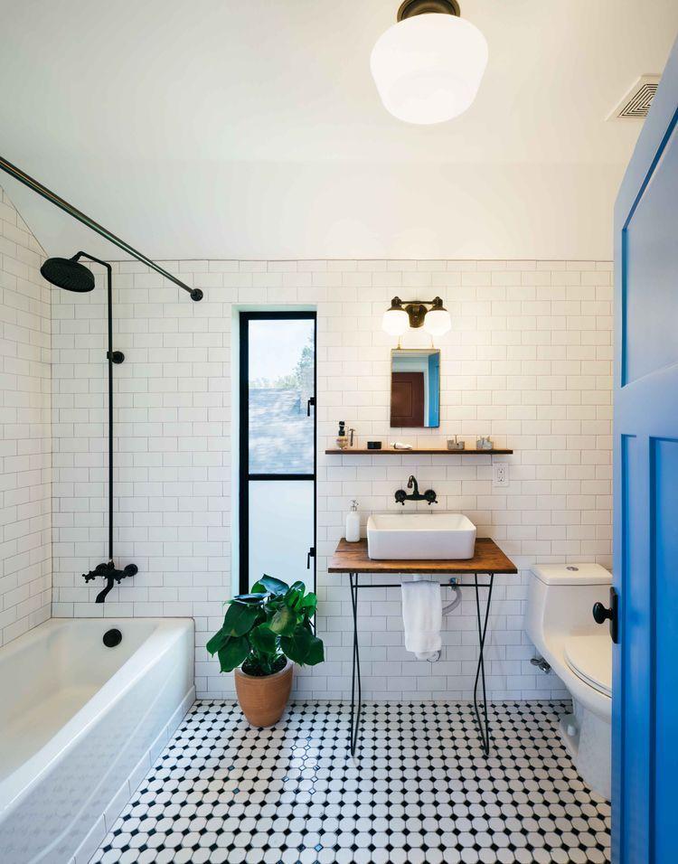 modern farmhouse austin texas bath subway tiles on the walls and basic octagonal and