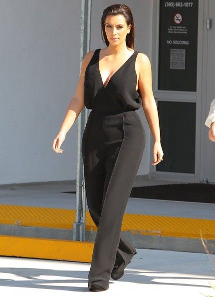 901623d37b4 Kim Kardashian Jumpsuit - Kim Kardashian suited up a black onesie with a  plunging neckline for a furniture-shopping trip in Miami.