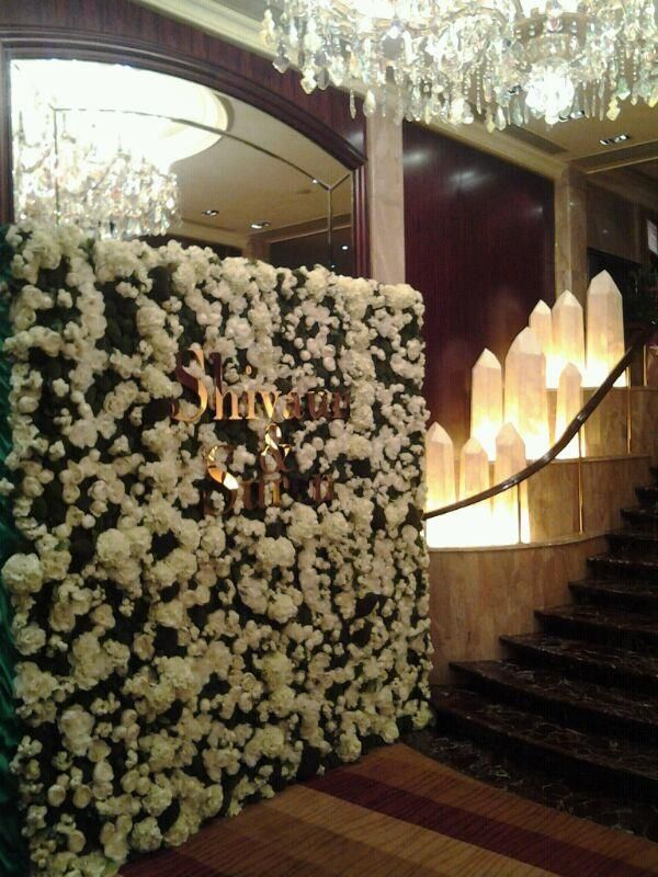 entrance backdrop with couples logo and flowers to match