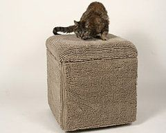 Here's the piece of furniture made with fabric that was made for your cat to scratch up! Brilliant!