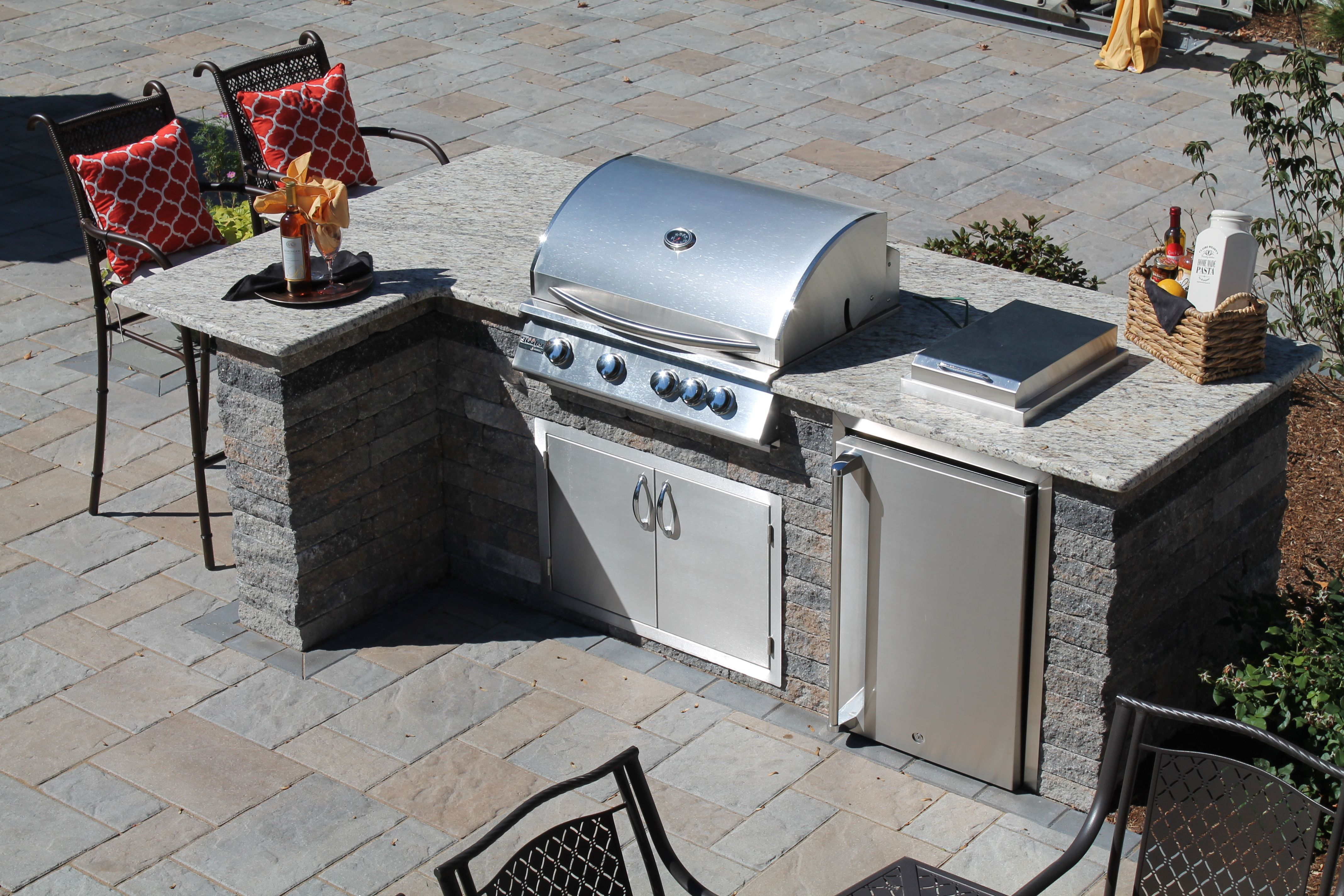 An Outdoor Kitchen With A Grill Fridge Side Burner And Storage With A Granite Counter By Bahler Brothers Outdoor Grill Station Decks Backyard Outdoor Kitchen