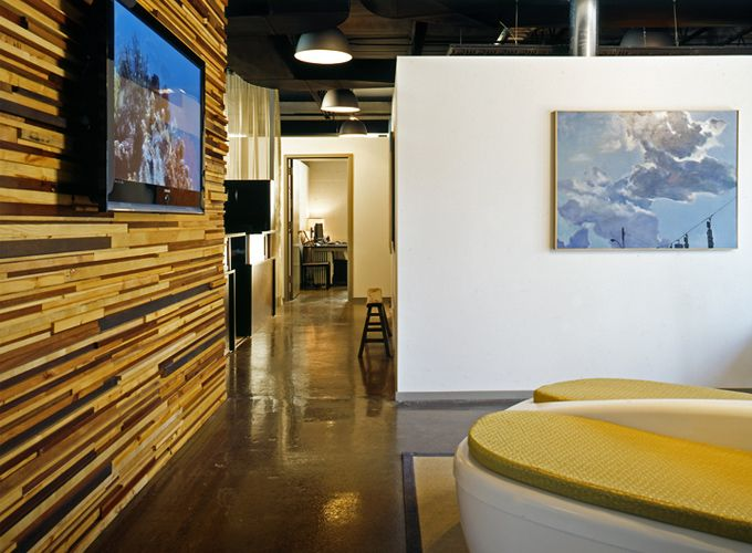 Stained concrete floors and a custom wood plank wall for Focal point flooring