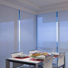 White Sunfilter Roller Blinds Taking Away The Evening Glare Over Dinner By Curtain Design Blinds Design Blinds And Curtains Living Room Modern Blinds