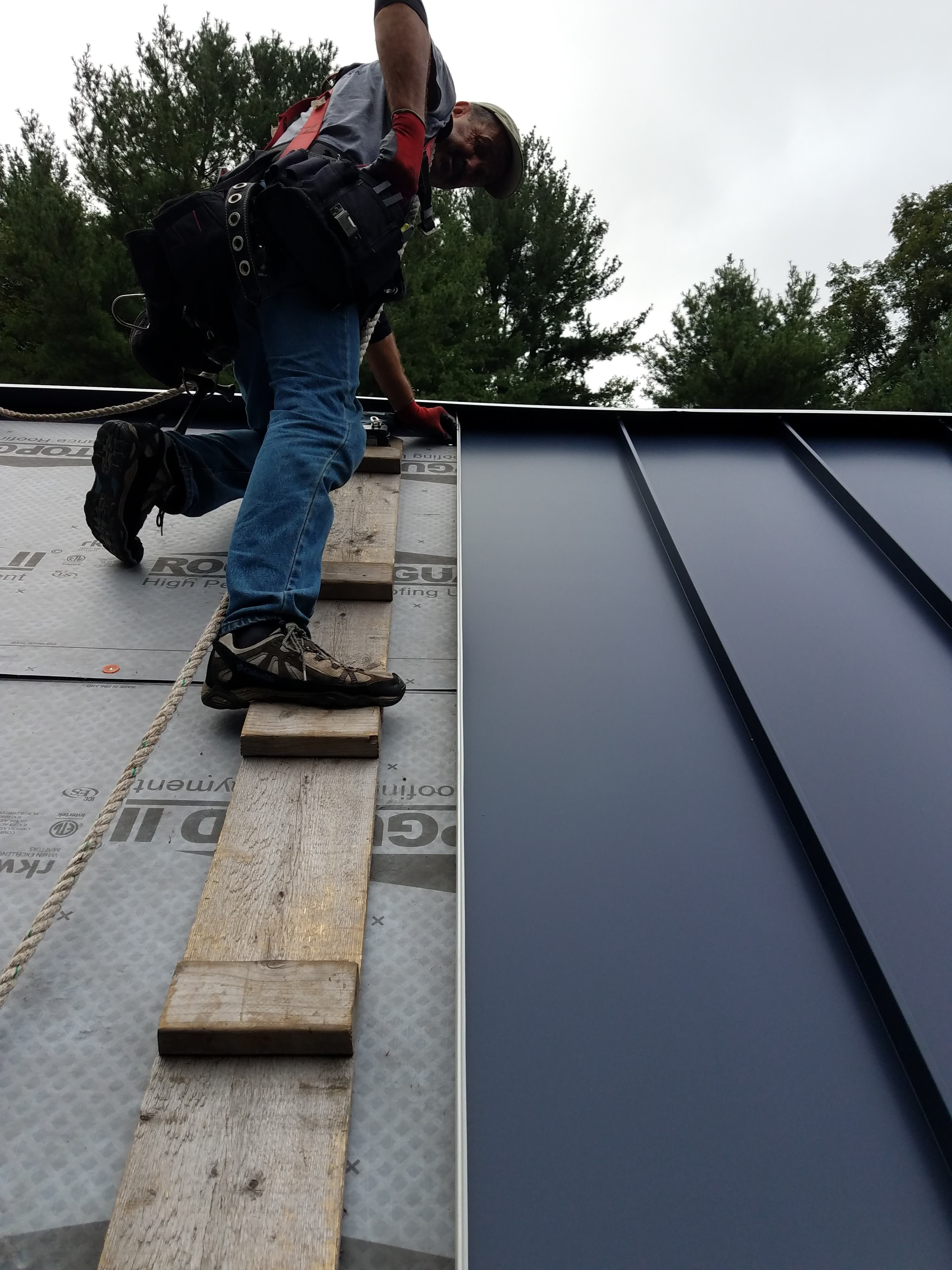 Installing Standing Seam Panels On A Steep Pitched Roof In 2020 Standing Seam Metal Roof Standing Seam Roof Roof Cladding