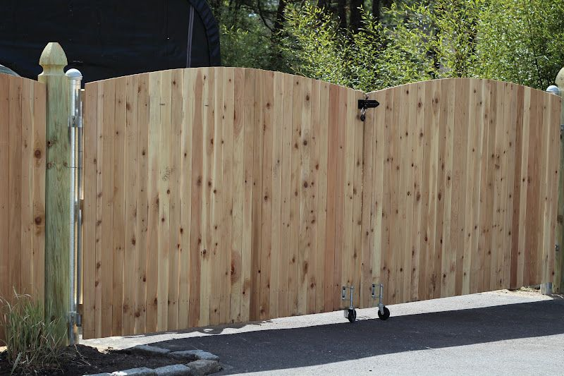 Double swing wood fence gate spring loaded rollers to for Double wooden driveway gates