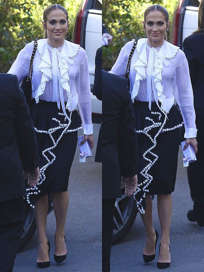 562e1fad60b Jennifer Lopez went the demure route this time in a Givenchy  pearl-embellished ruffle-front blouse and matching pencil skirt