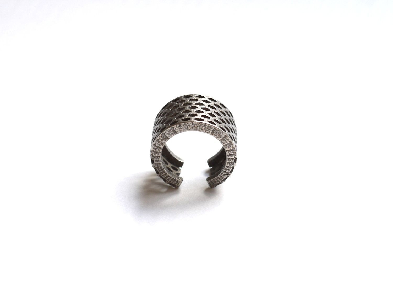 3d printed Perforated Elongated Honeycomb Ring in stainless steel
