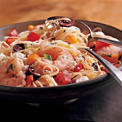 Pasta Salad with Shrimp, Peppers, and Olives - Toss angel hair pasta with shrimp, plum tomatoes, bell peppers, and olives for a Mediterranean-style main dish salad. Sprinkling with a small amount of sharp feta cheese gives the salad its distinct flavor, yet adds very little fat to the dish–a 2-cup serving has only 7.2 grams of fat.